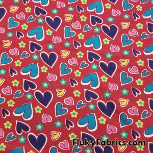 Colorful Hearts on Red Cotton Jersey  Fabric