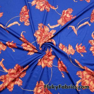 Big Orange Flowers on a Royal Background Triblend Jersey Fabric