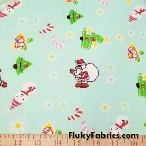 Christmas Print on Mint Background Cotton Rib Fabric