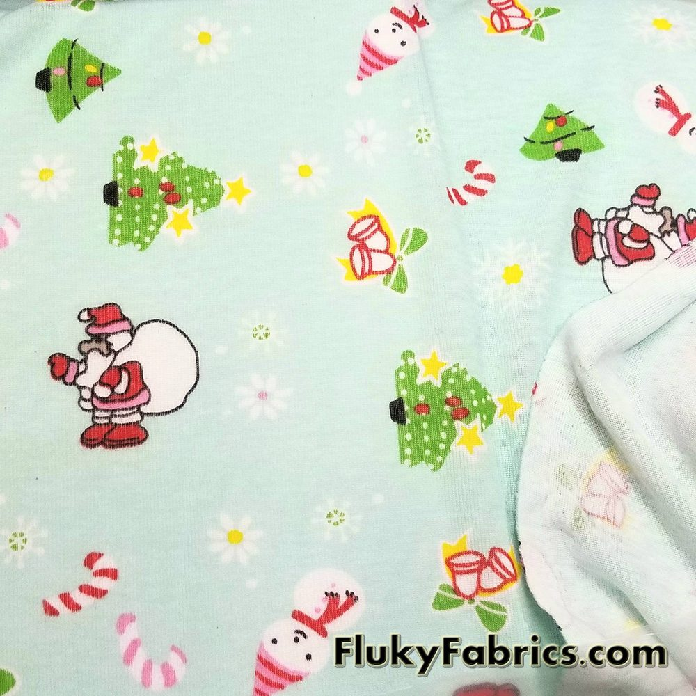 Christmas Print on Mint Background Cotton Rib Fabric  Fabric