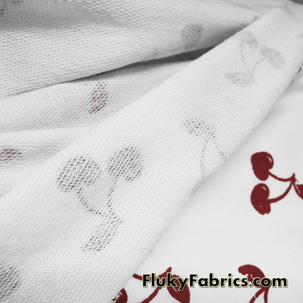 French Terry 100% Cotton Fabric with Distressed Dark Red Cherries Print on White  Fabric