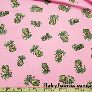Pineapples on Fire over a Pink Background Nylon Spandex Fabric