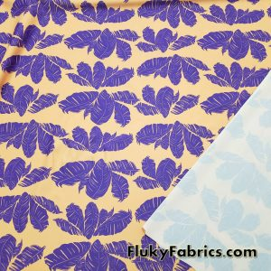 Purple Feathery Leaves on a Peach Background Nylon Spandex Fabric  Fabric
