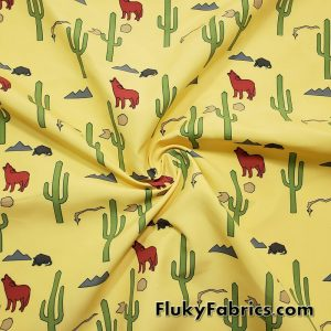 Desert Life, Cactus, Wolves, Snakes and Rocks on Yellow Boardshort Fabric