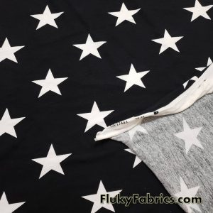 White Stars on Black Cotton Lycra Fabric
