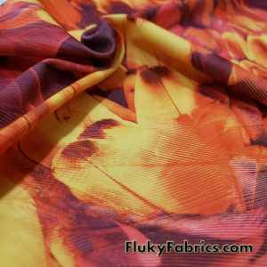 Lightweight Abstract Feathers in Sunset Colors Screen Print Nylon Spandex Fabric