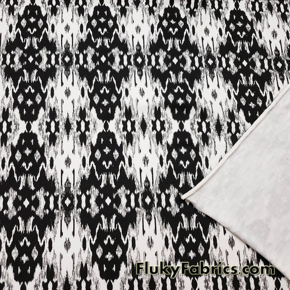 Ikat Black and Off White Cotton Lycra Apparel Fabric  Fabric