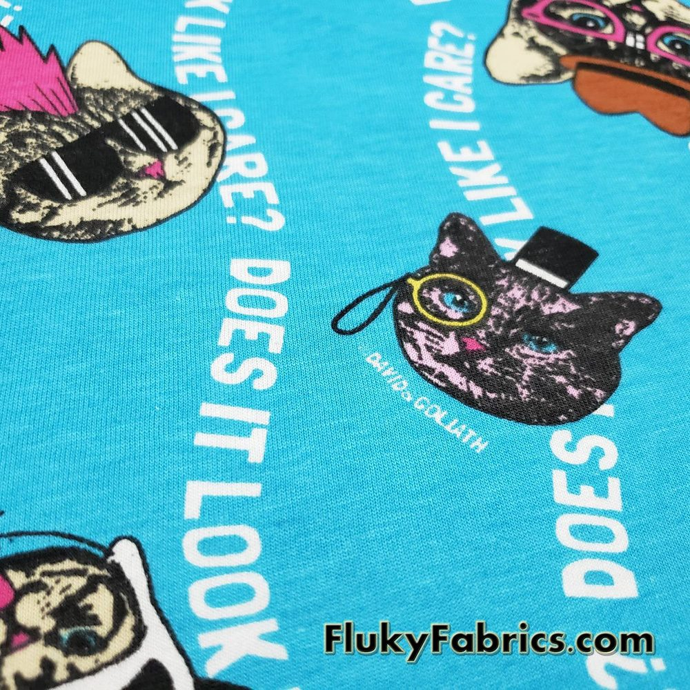 Cool Cats Cotton Jersey, Does It Look Like I Care? David and Goliath Print Cotton Knit Fabric  Fabric