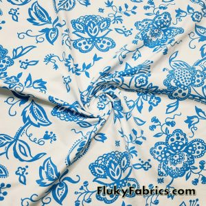 Turquoise Blue Flowers, Vines and Leaves on a White Background Nylon Spandex Fabric