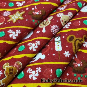 Gingerbread, Cookies, Candy Christmas Treats and Everyones Favorite Mouse on Red Print Cotton Jersey