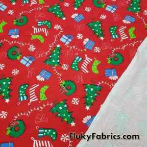 Christmas Motifs on a Red Background Cotton Rib Fabric  Fabric
